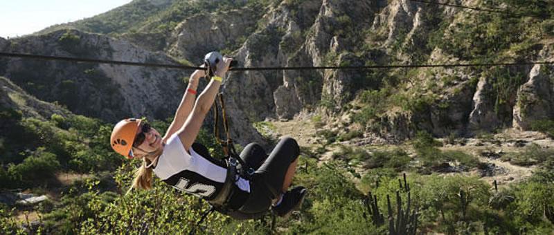 photo of person on zipline